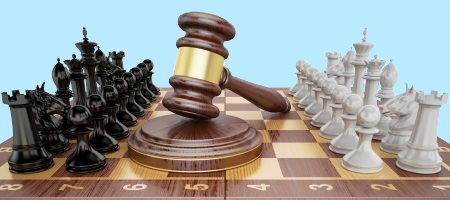 Lawyers playing chess with gavel